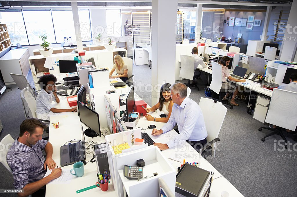 People working in a busy office stock photo