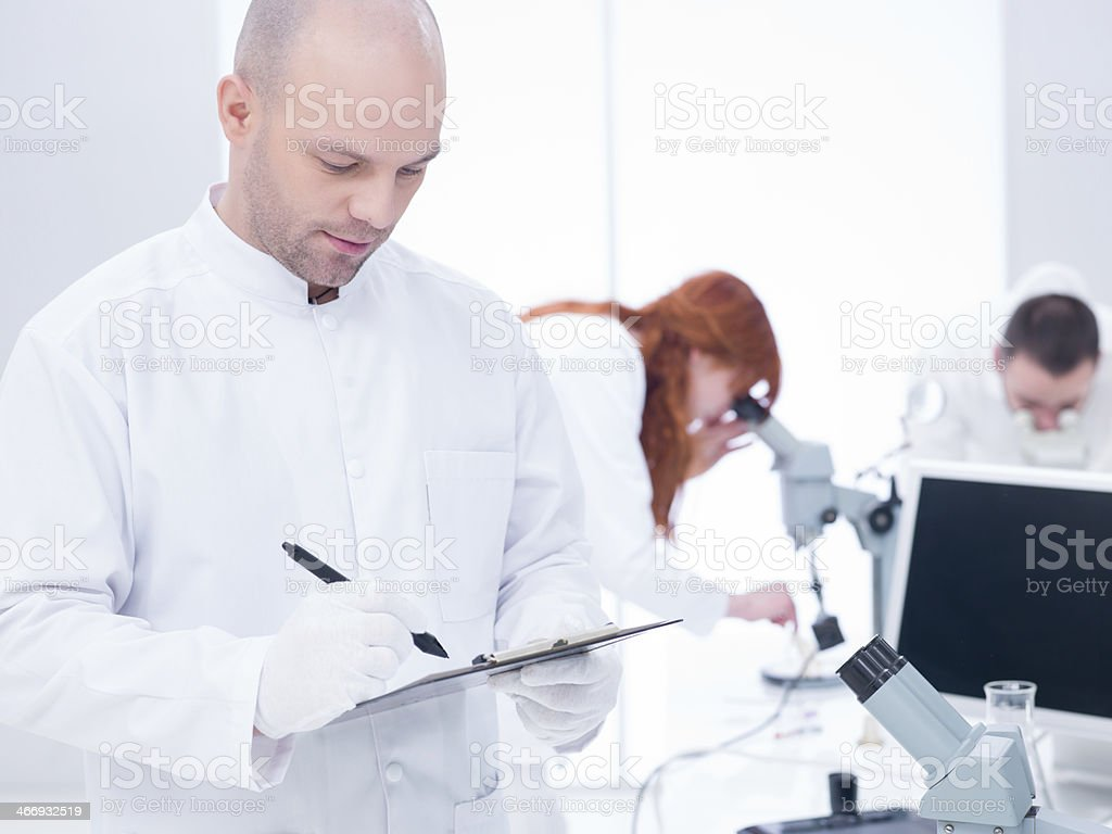 people working in a chemistry lab royalty-free stock photo