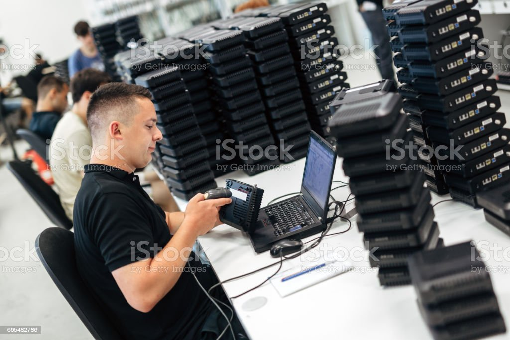 People working in network industry checking products stock photo