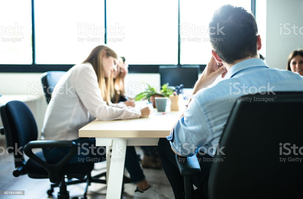 people working in the office stock photo