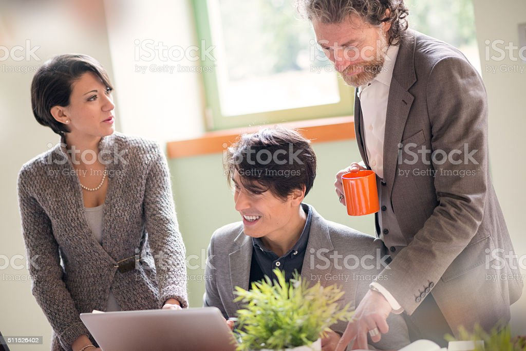 People working in young startup coworking business stock photo
