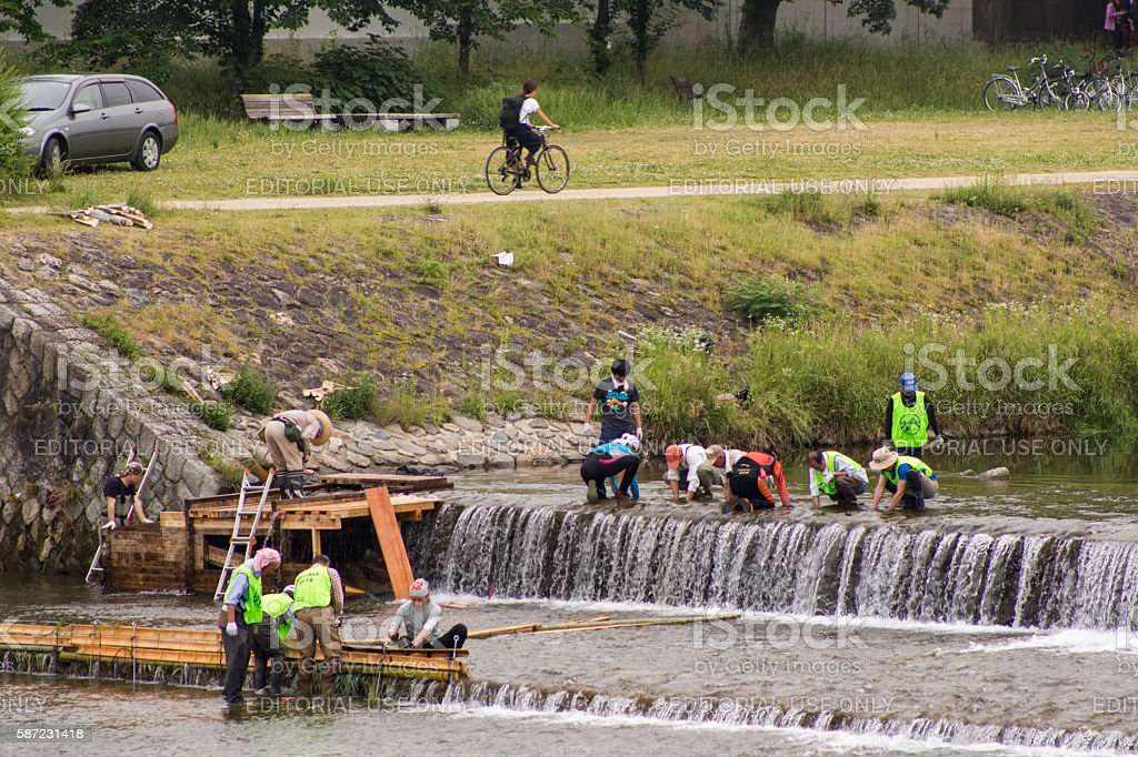 People working on kamo river decoration of kyoto japan stock photo