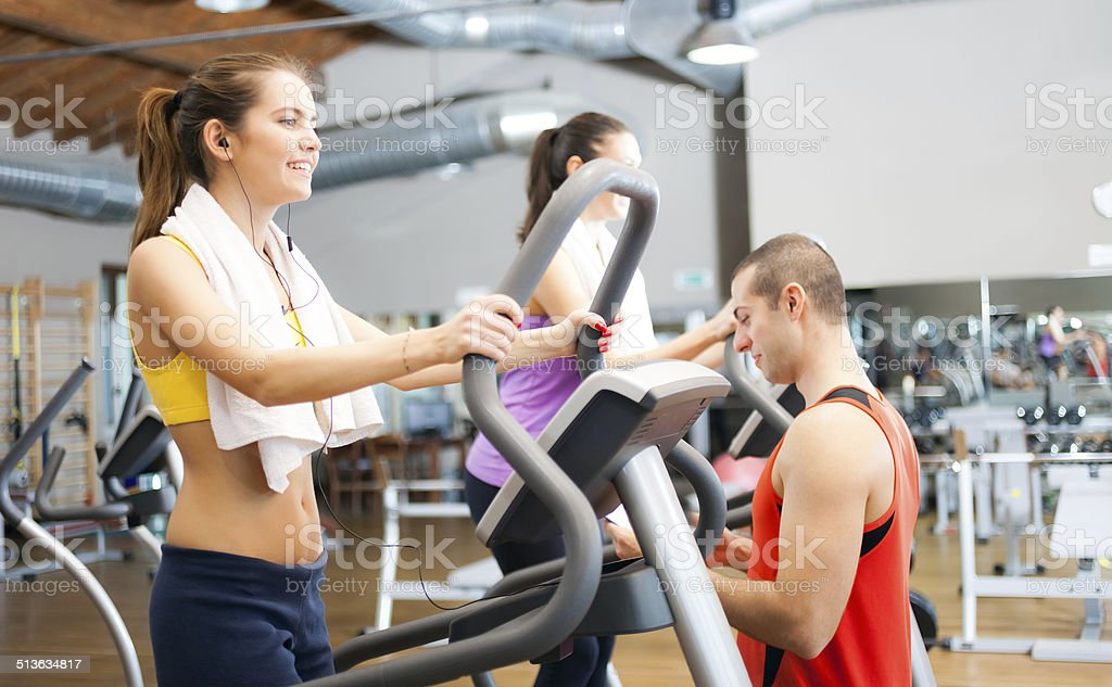 People working out in a gym stock photo
