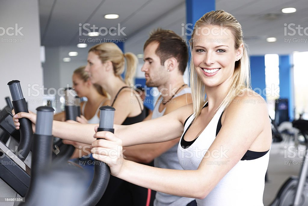 People Working Out on Elliptical Machines royalty-free stock photo