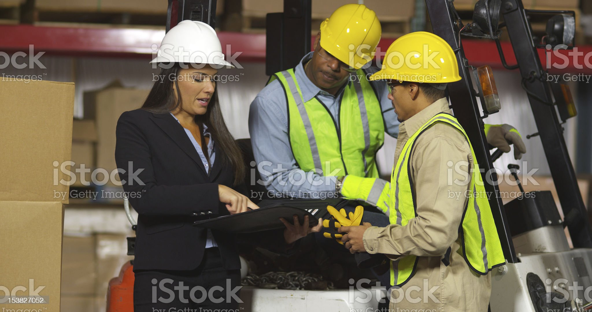 People working together in shipping warehouse royalty-free stock photo