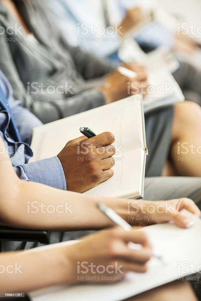 People writing on a seminar royalty-free stock photo