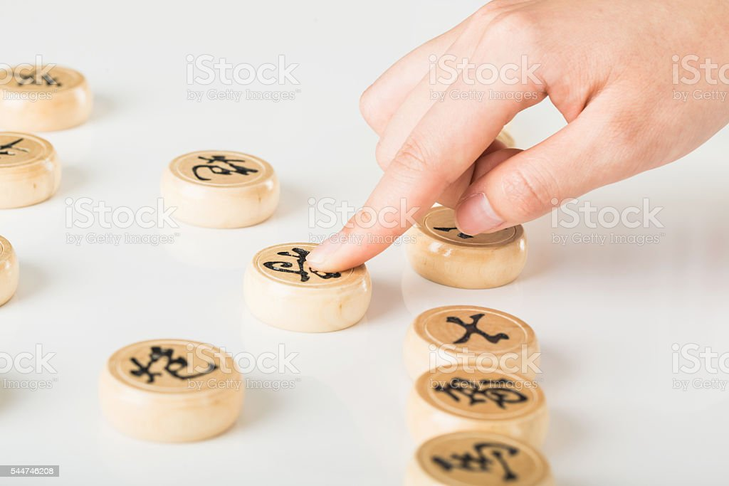 people's hand and Chinese chess stock photo