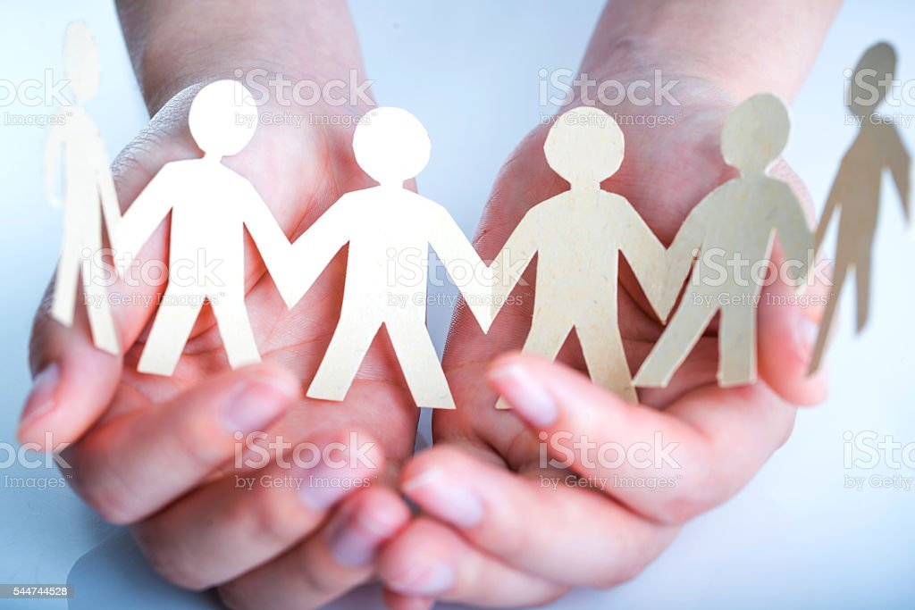 people's hand and paper men stock photo
