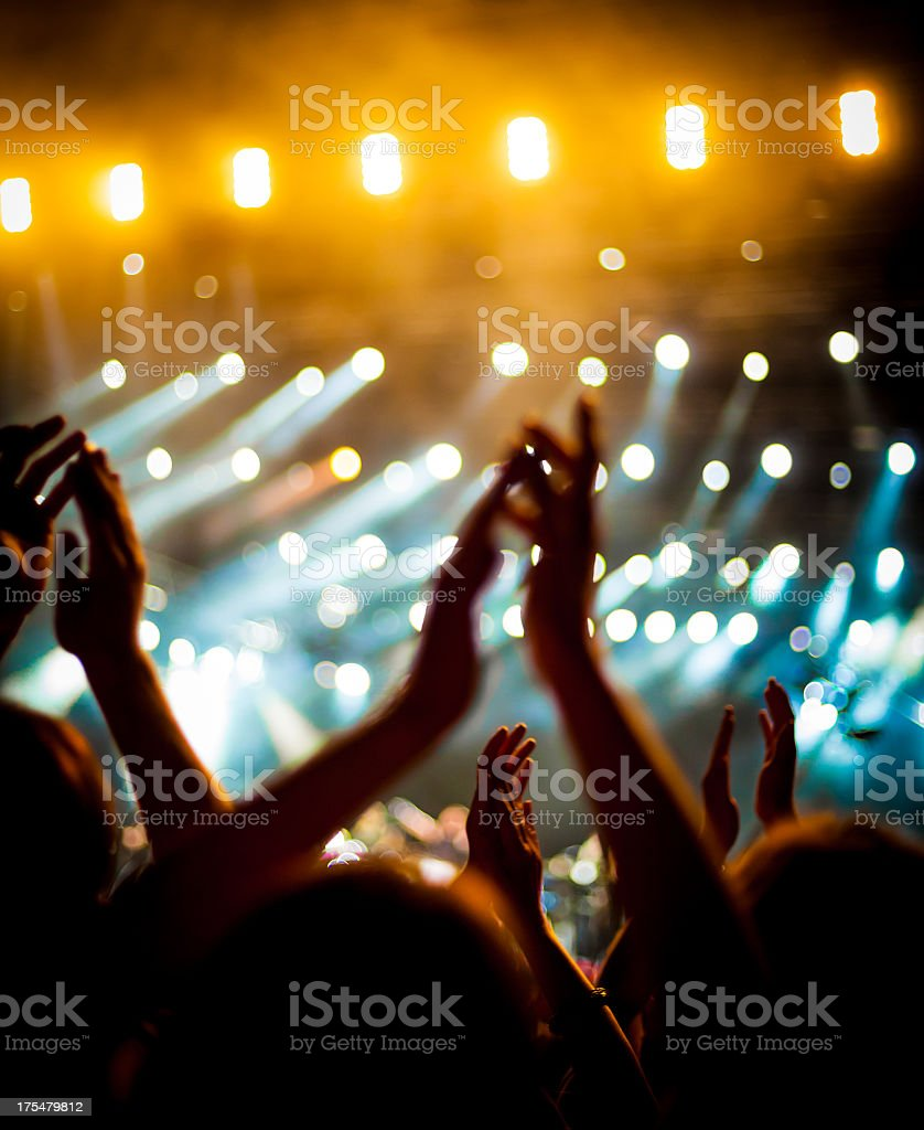 Peoples hands clapping above their head at concert royalty-free stock photo