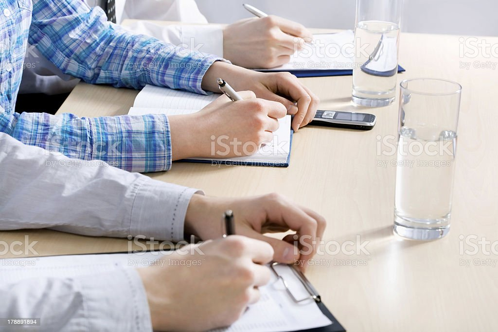 People's hands writing royalty-free stock photo