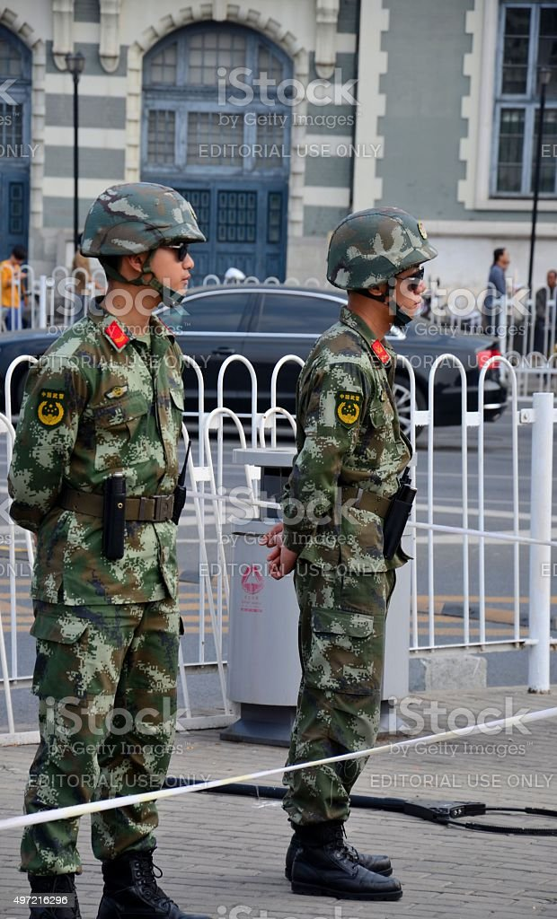 People's Liberation Army soldiers stand guard Tiananmen Square Beijing China stock photo