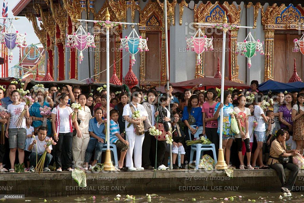 Peoples wait is throwing lotus on Rub Bua Festival,Thailand. stock photo