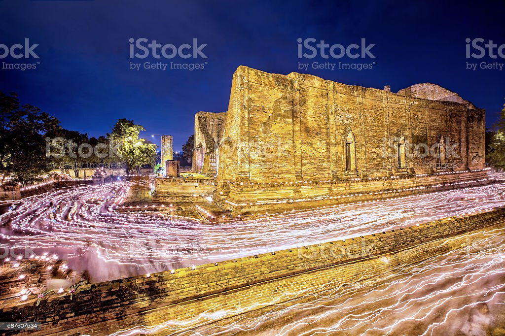 Peoples walking with lighted candles around ancient temple stock photo
