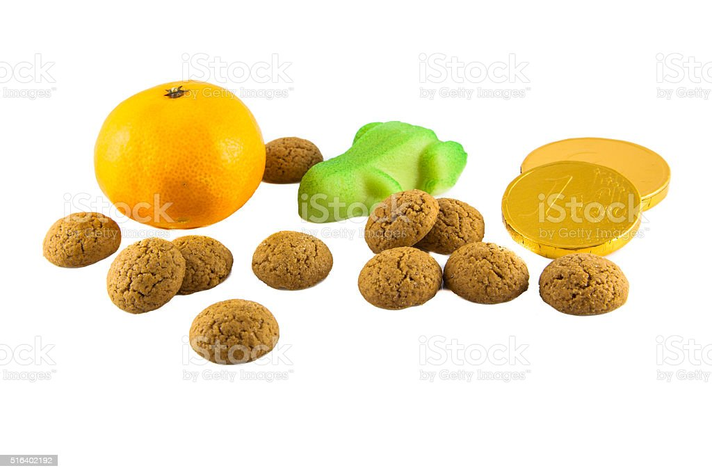 Pepernoten, candy and fruit on white stock photo