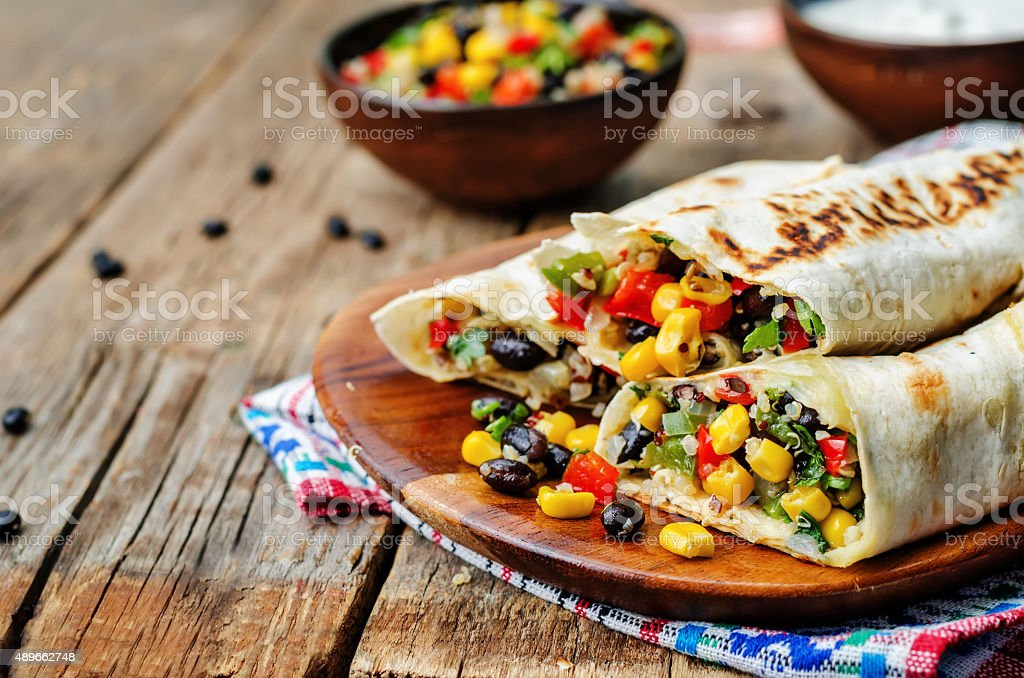 pepper corn black bean quinoa burritos stock photo