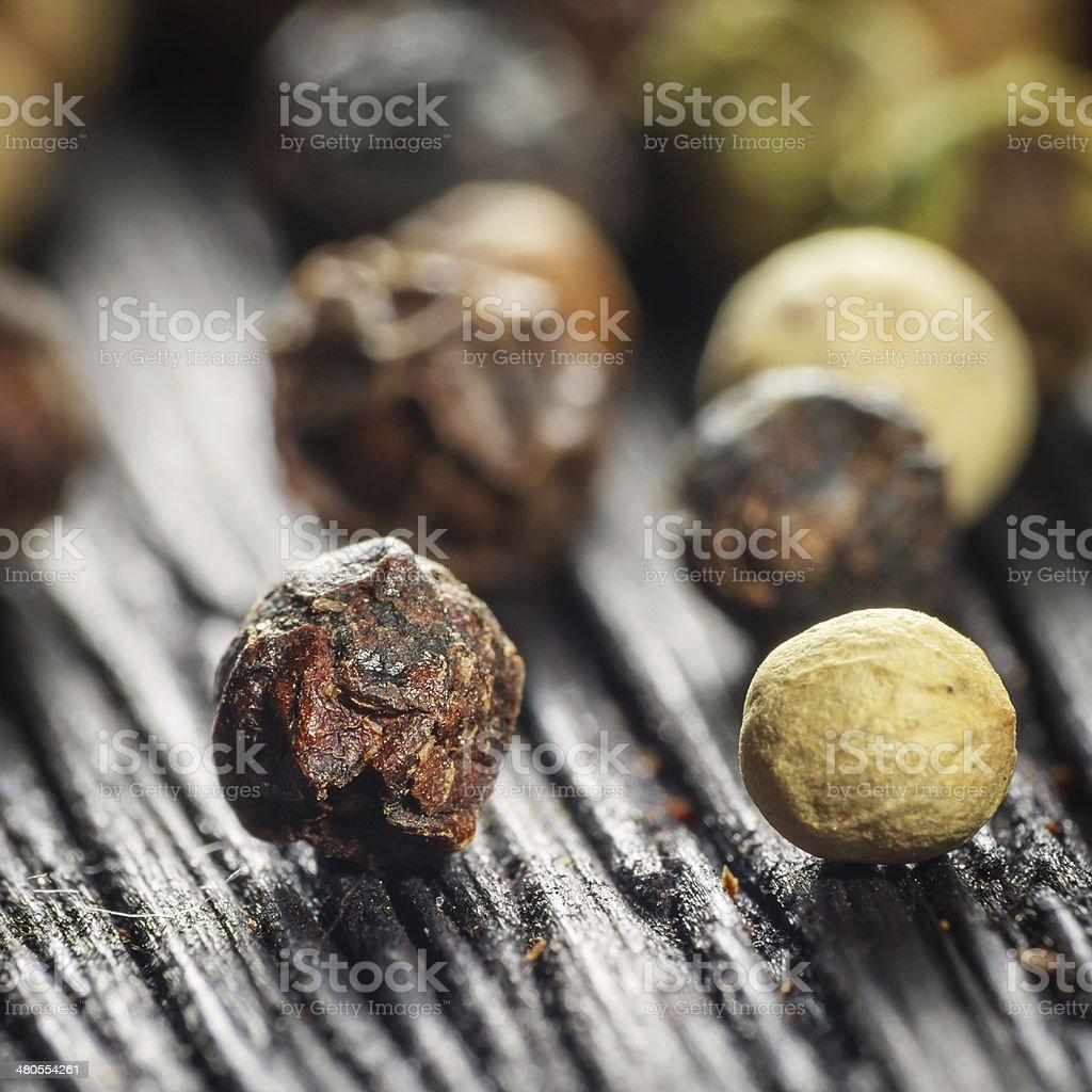 pepper corns on a wooden board stock photo