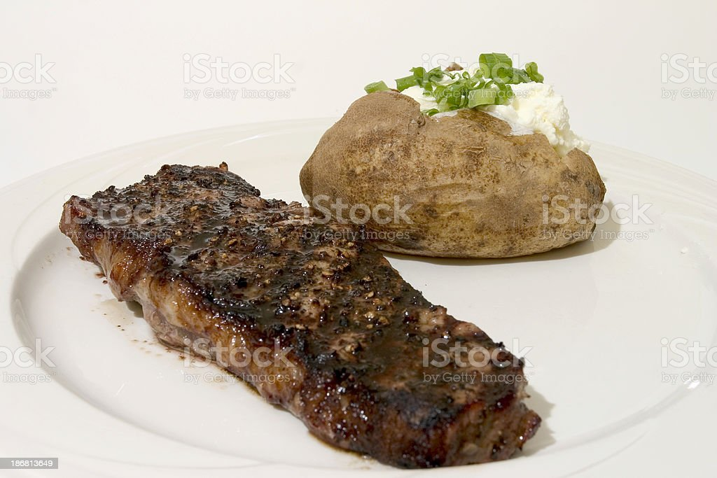 Pepper Crusted NeW York Steak stock photo