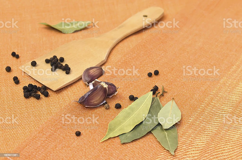 Pepper, garlic, bay leaf and wooden shovel. royalty-free stock photo