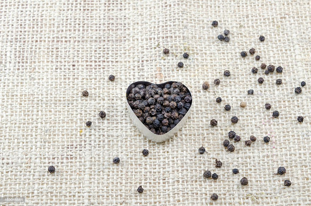 Pepper in a heart shaped box royalty-free stock photo