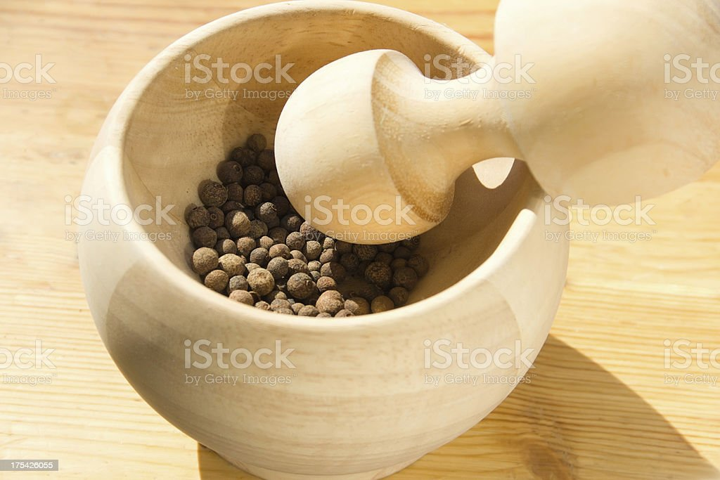 pepper in a wooden mortar royalty-free stock photo