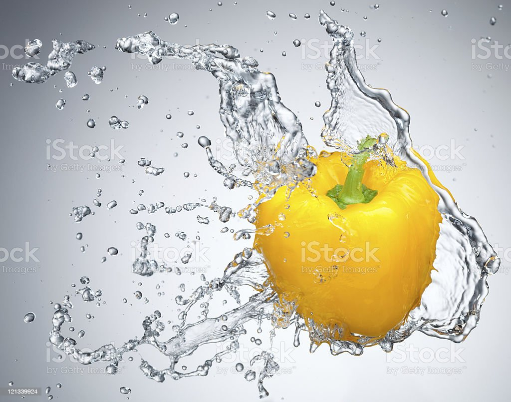 Pepper in spray of water. stock photo