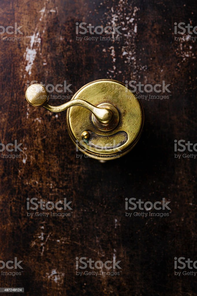 Pepper mill on metal dark texture stock photo