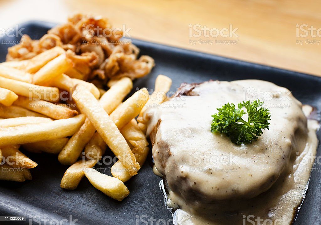 Pepper steak and french fries stock photo