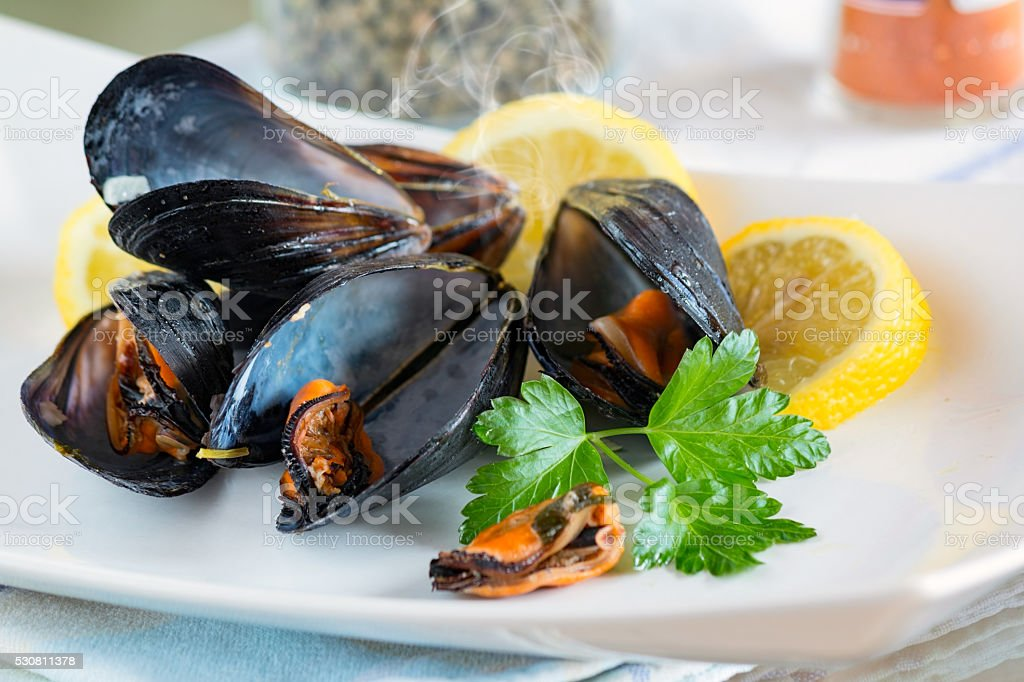 peppered mussels stock photo