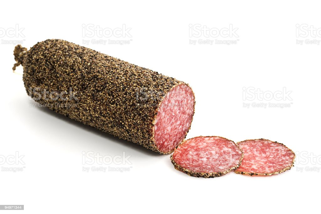 peppered salami sausage and slices royalty-free stock photo