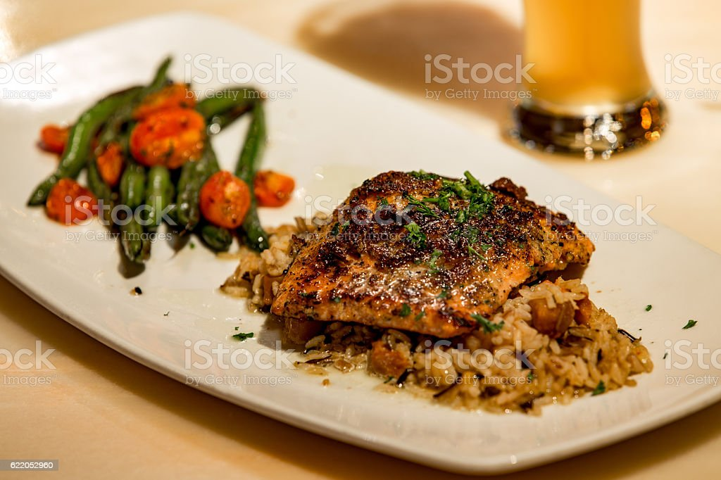 Peppered salmon over rice stock photo