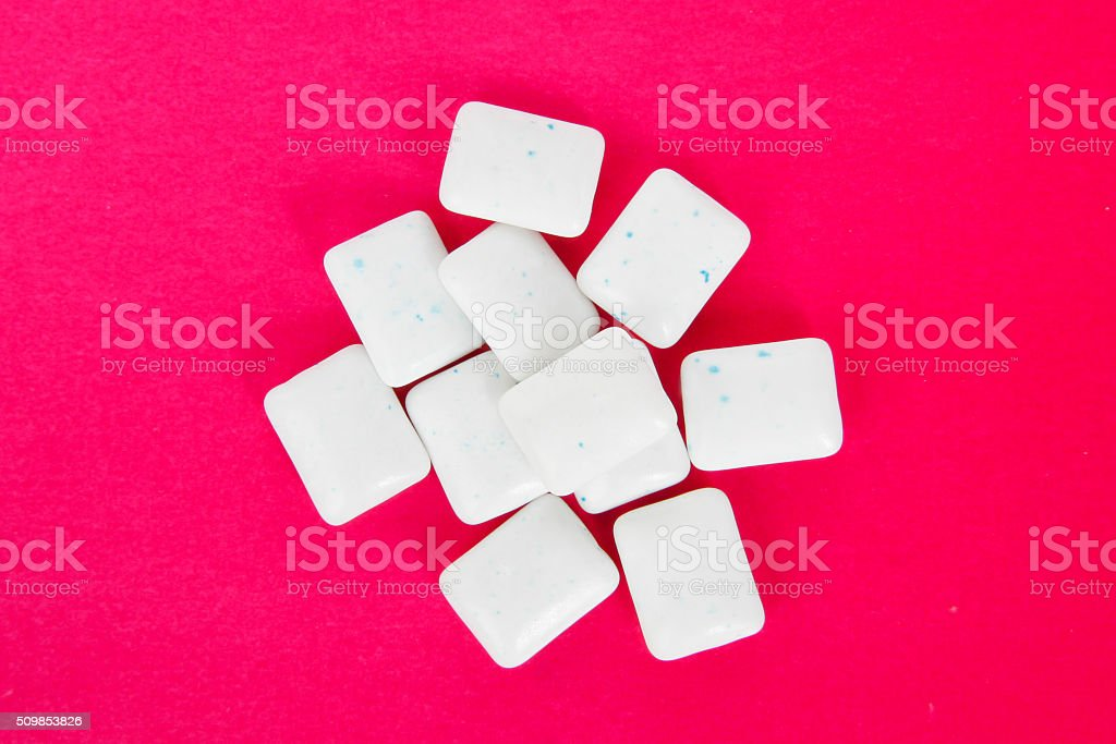 peppermint chewing gum on red background stock photo