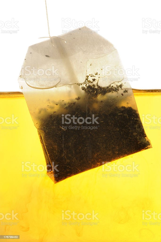 Peppermint Tea bag hanging into hot water royalty-free stock photo