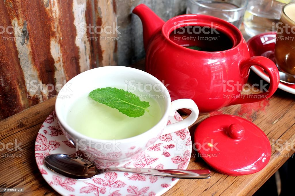 Peppermint tea in vintage cup stock photo