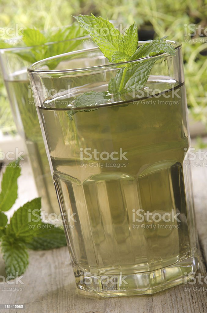 peppermint tea with mint in the background royalty-free stock photo