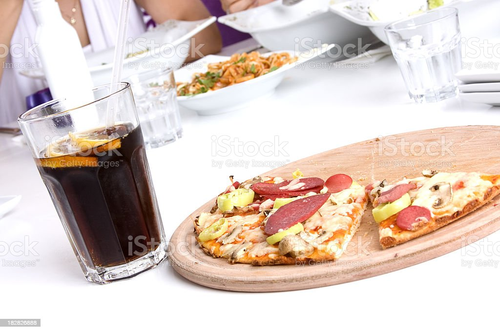 Pepperoni pizza and cola royalty-free stock photo