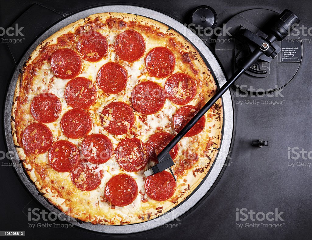 Pepperoni Pizza on Record Player Turntable stock photo