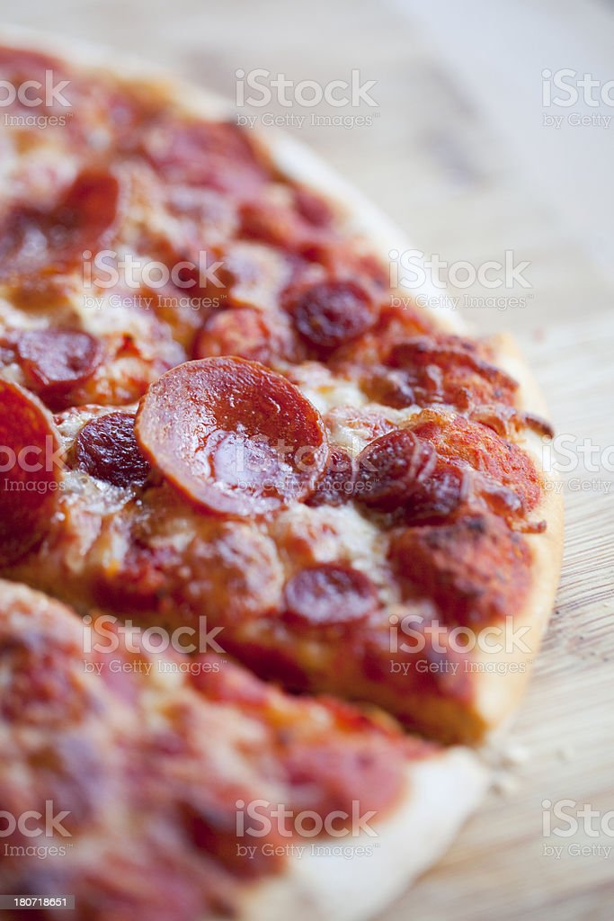 Pepperoni pizza on wooden board royalty-free stock photo