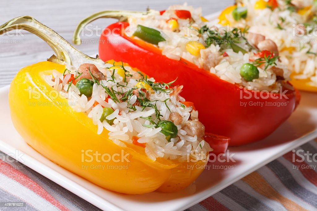 peppers filled with rice, vegetables and meat close up stock photo