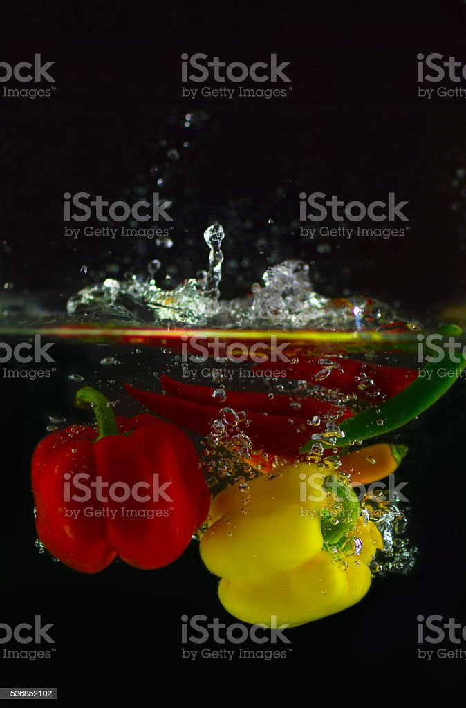 Peppers in water stock photo