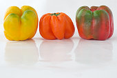 Peppers of different colors with water droplets