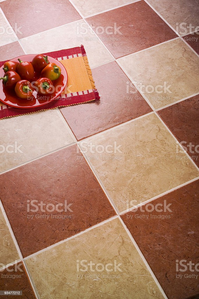 Peppers over ceramic tiles royalty-free stock photo