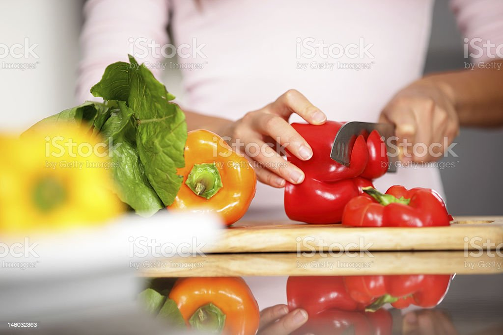 Peppers - woman cutting red pepper royalty-free stock photo