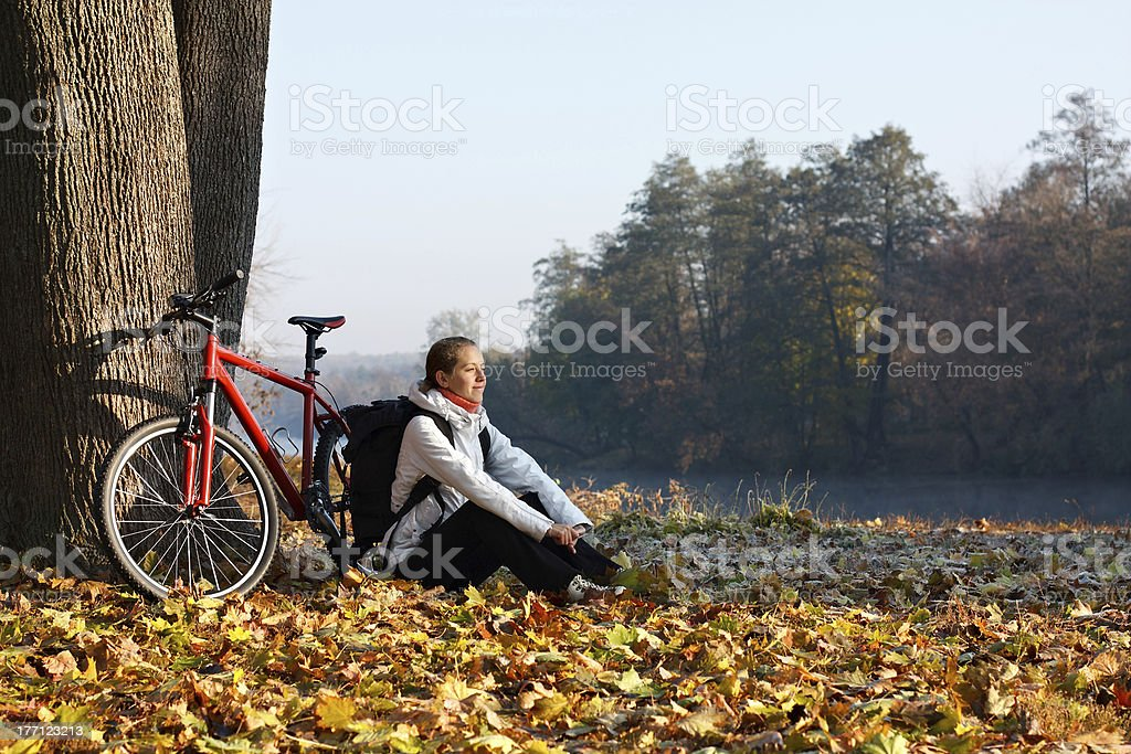 Peppy woman cyclist enjoy the recreation autumn morning in natur stock photo