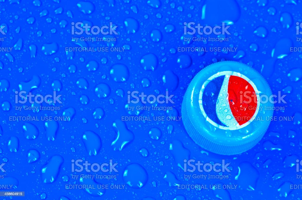 Pepsi Cola bottle cap on blue and wet surface royalty-free stock photo
