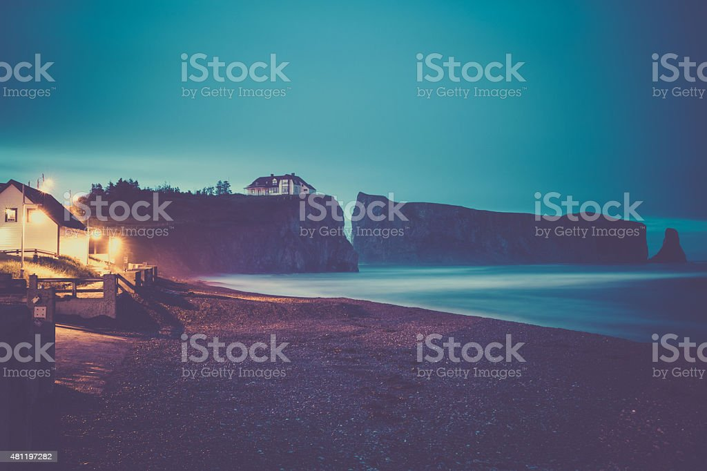 Perce Rock in Perce at Night, Quebec Canada stock photo