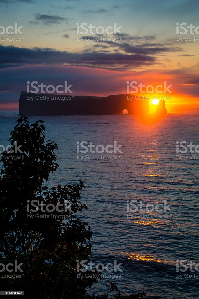 Perce Rock on the Gaspe Peninsula at Sunrise stock photo