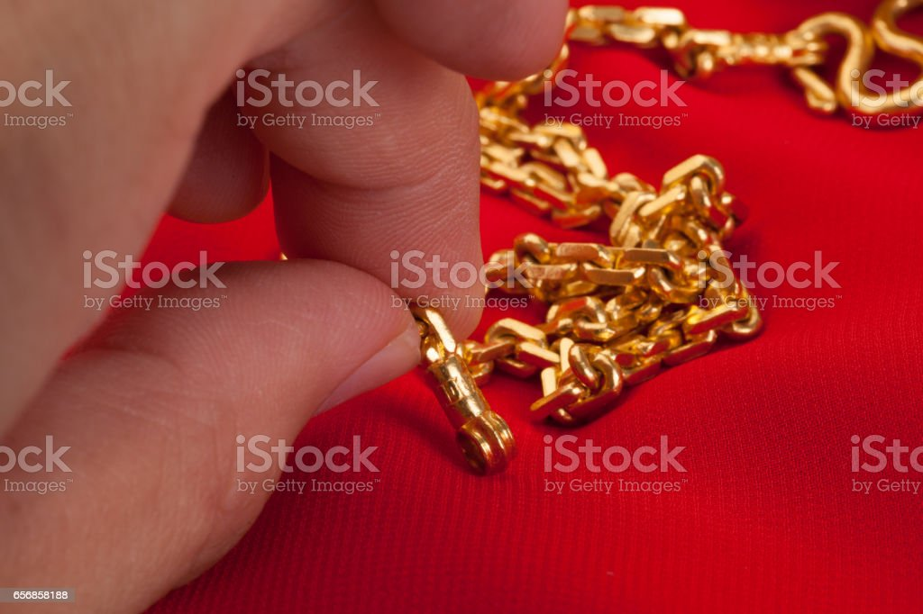 100 percent gold necklace on the red carpet. stock photo