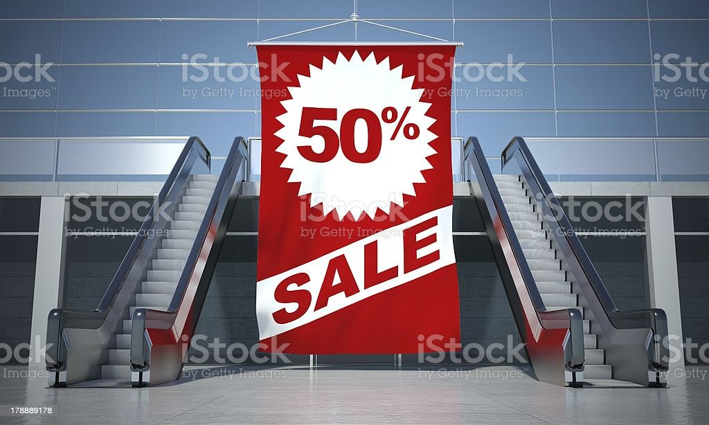 50 percent sale advertising flag and escalator royalty-free stock photo