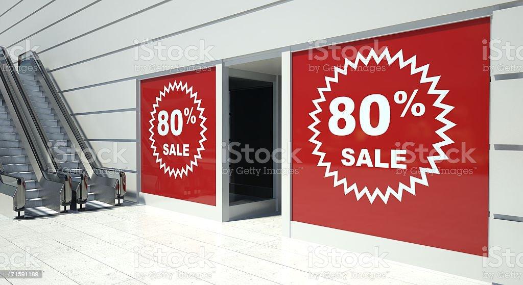 80 percent sale on shopfront windows and escalator royalty-free stock photo