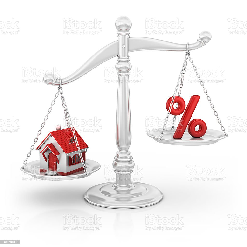 percentage sign and house on scale royalty-free stock photo